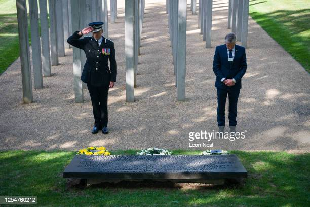 Chief Constable of the British Transport Police Paul Crowther and Commissioner of Transport for London Mike Brown lay wreaths at the 7/7 memorial in...