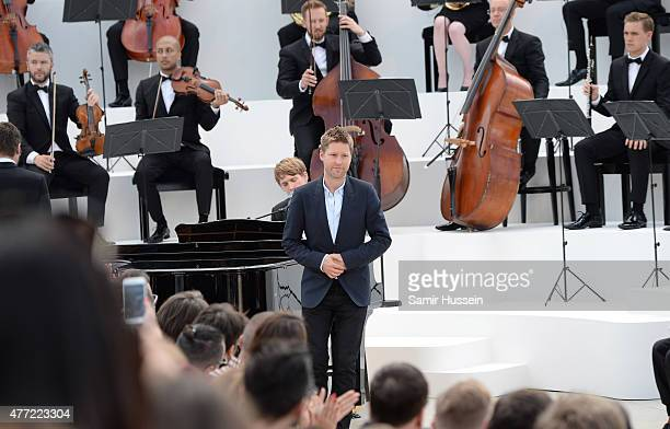 Chief Creative and chief executive officer of Burberry, Christopher Bailey takes a bow after the Burberry Menswear Spring/Summer 2016 show at...