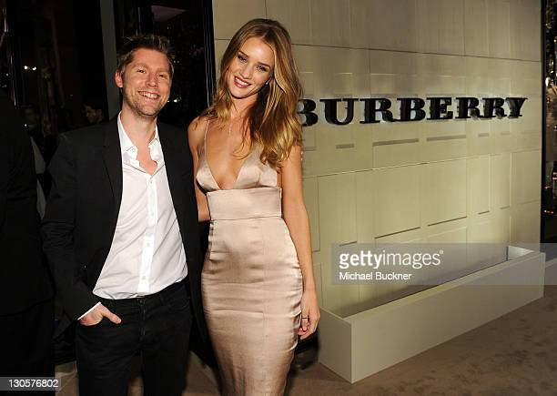 Chief Creative Officer of Burberry Christopher Bailey and model Rosie Huntington-Whiteley arrive at the Burberry Body Event hosted by Christopher...