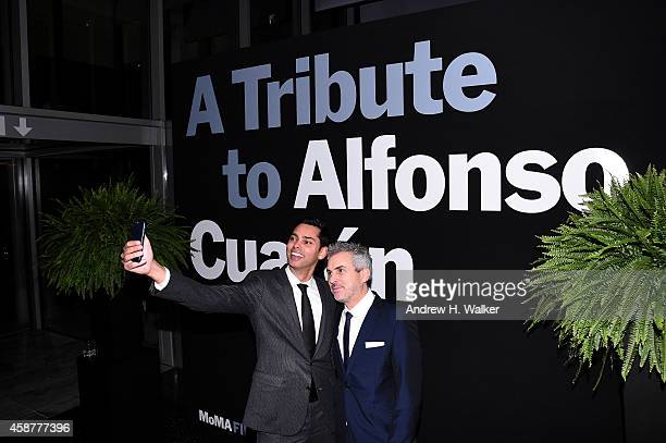 Chief Curator of Film Rajendra Roy and Honoree and Director Alfonso Cuaron attend The Museum of Modern Art's 2014 Film Benefit Honoring Alfonso...