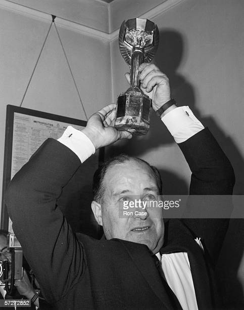 Chief Detective Superintendent John Baily holds aloft the World Cup at Cannon Row police station after it was successfully recovered following its...