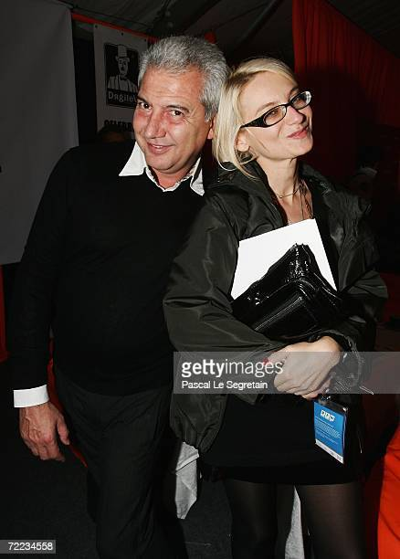 Chief Editor of Officiel Russia magazine Evelina Khromchenko and Sergeo Pea attend the Dmitry Loginov for Donatto Fashion Show as part of Russian...