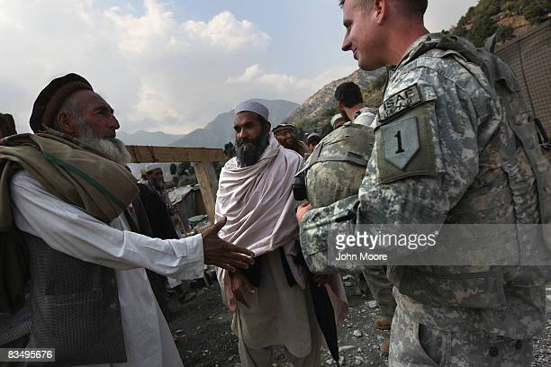 Chief elders of the Korengal Valley arrive for a meeting with US and Afghan military officials October 30 2008 at the Korengal Outpost in eastern...