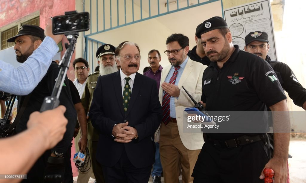 Chief Election Commissioner of Pakistan Sardar Muhammad Raza Khan arrives to visit a polling station during the general elections in Rawalpindi...