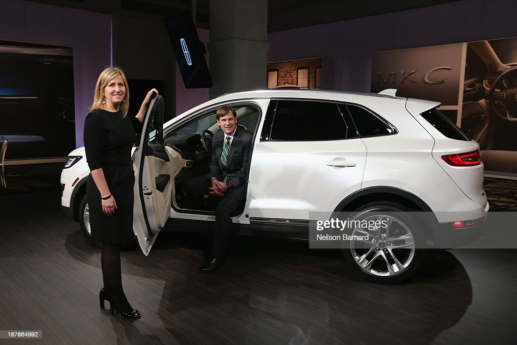 Chief Engineer Lisa Drake and Executive VP of Ford Global, Marketing, Sales and Service and Lincoln, Jim Farley with all-new 2015 Lincoln MKC on November 13, 2013 in New York City.