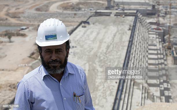 Chief Engineer Simegnew Bekele poses on March 31 2015 during a tour of the Grand Renaissance Dam under construction near the SudaneseEthiopian border...