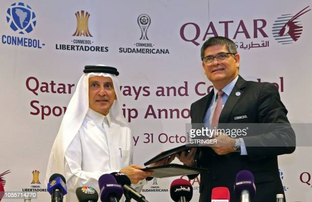 Chief Excecutive Officer of Qatar Airways Akbar alBaker and Jose Manuel Astigarraga the secretary general of the South American football federation...