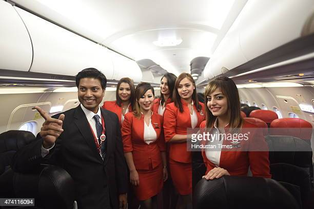 Chief Executive AirAsia Mittu Chandilya with crew members after its test flight started from Delhi from Indira Gandhi International Airport on May 20...