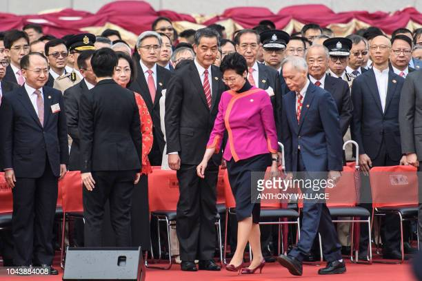 Chief Executive Carrie Lam and her husband Lam Siupor walk past former chief executive Leung Chunying and his wife Regina Leung Tong Chingyee after a...