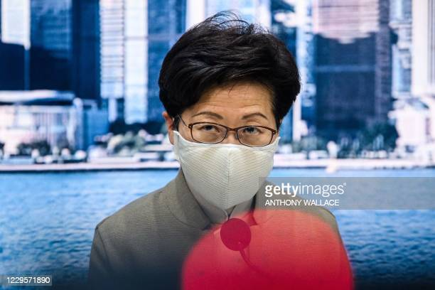 Chief Executive Carrie Lam speaks during a press conference at the government headquarters in Hong Kong on November 11, 2020. - Hong Kong stripped...