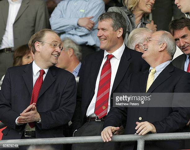 Chief Executive David Gill of Manchester United laughs with Finance Director Nick Humby and nonexecutive director Michael Edelson during the Barclays...