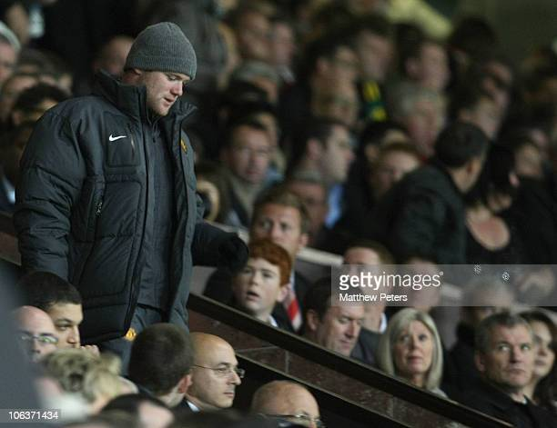 Chief Executive David Gill of Manchester United watches as Wayne Rooney leaves his seat in the stand during the Barclays Premier League match between...