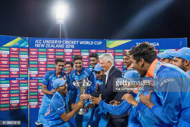 Chief Executive David Richardson presents the trophy to captain Prithvi Shaw of India following the ICC U19 Cricket World Cup Final match between...