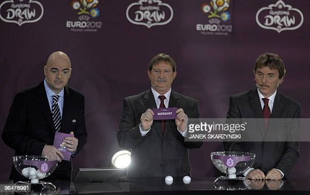 Chief Executive Gianni Infantino former football player Andrzej Szarmach and Zbigniew Boniek from Poland present the ceremony for the qualifying...