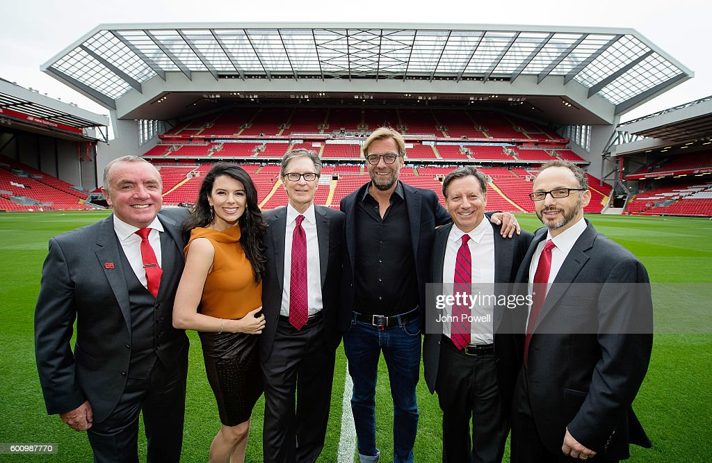 Chief Executive Ian Ayre, Linda Pizzuti Henry, Principal Owner John W. Henry, team manager Jurgen Klopp, Club Chairman Tom Werner, and President Mike Gordon attend the opening event at Anfield on September 9, 2016 in Liverpool, England.
