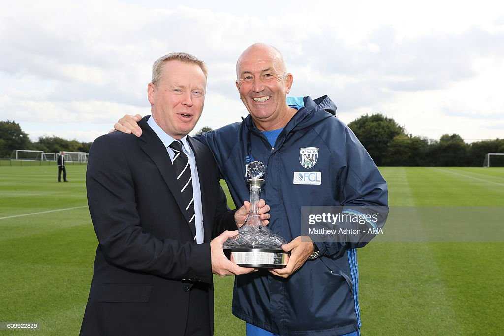 Chief Executive Mark Jenkins of West Bromwich Albion presents Head Coach Tony Pulis with a Ship's Decanter to commemorate his 1000th match as a manager at West Bromwich Albion Training Ground on September 23, 2016 in Walsall, England.