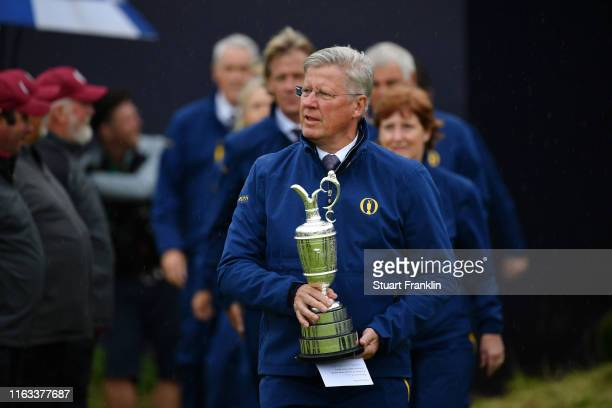 Chief Executive Martin Slumbers brings out the Claret Jug for the trophy presentation on the 18th green during the final round of the 148th Open...