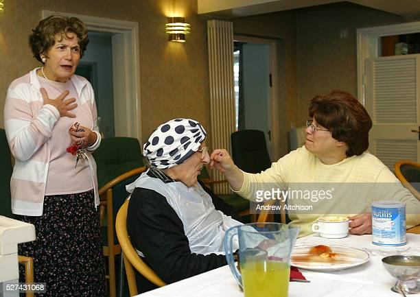 Chief executive of Agudas Israel Housing Association Itta Symons talking with staff and clients while they have lunch in Schonfeld square, an...