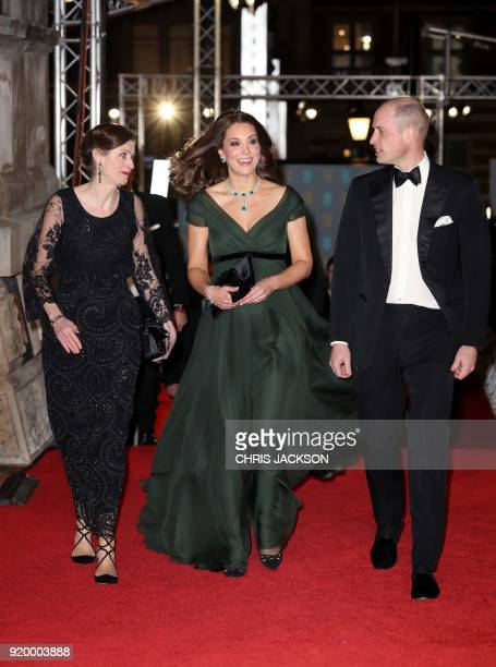 Chief Executive of BAFTA Amanda Berry greets Britain's Prince William Duke of Cambridge and Britain's Catherine Duchess of Cambridge as they attend...