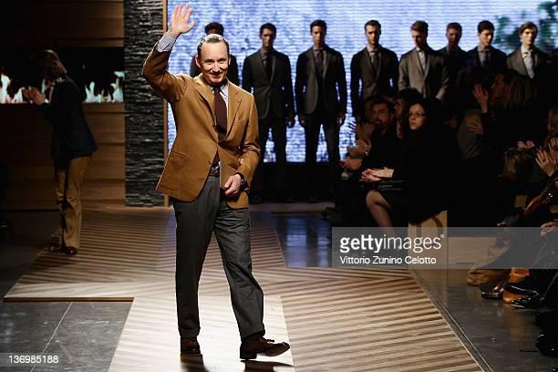 Chief executive of Ermenegildo Zegna Gildo Zegna acknowledges the applause of the audience after the Ermenegildo Zegna fashion show as part of Milan...