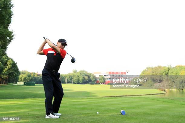 Chief Executive of HSBC Peter Wong plays his shot from the 18th tee during the proam prior to the WGC HSBC Champions at Sheshan International Golf...