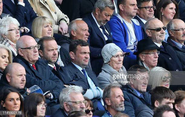 Chief Executive of Manchester United Ed Woodward and Sir Bobby Charlton look on during the Premier League match between Huddersfield Town and...