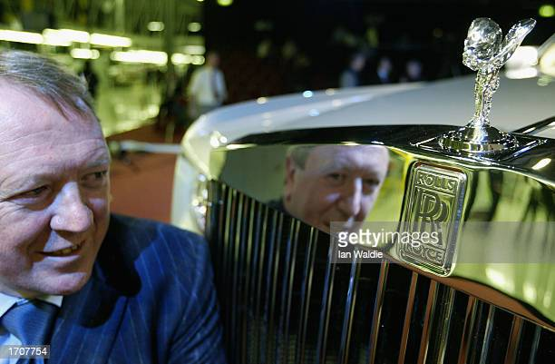 Chief Executive of RollsRoyce Tony Gott is reflected in the grille of the newly unveiled Phantom model January 3 2003 in Goodwood England The Phantom...