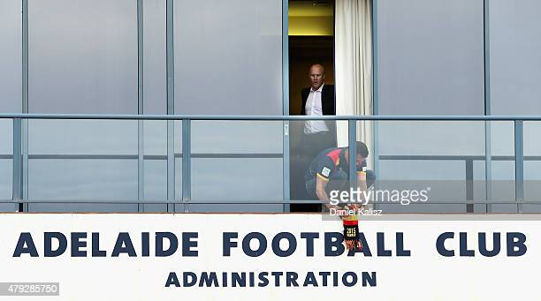 Chief Executive of the Adelaide Crows Andrew Fagan hangs a scarf out as a sign of remembrance as former Crows player Nigel Smart looks on at AAMI...