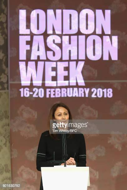 Chief Executive of the British Fashion Council Caroline Rush speaks on stage as Queen Elizabeth II awards designer Richard Quinn the inaugural Queen...