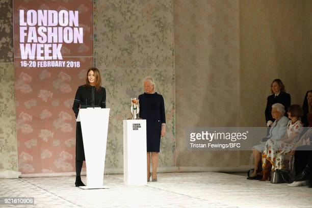 Chief Executive of the British Fashion Council Caroline Rush speaks on stage ahead of Queen Elizabeth II presenting designer Richard Quinn with the...