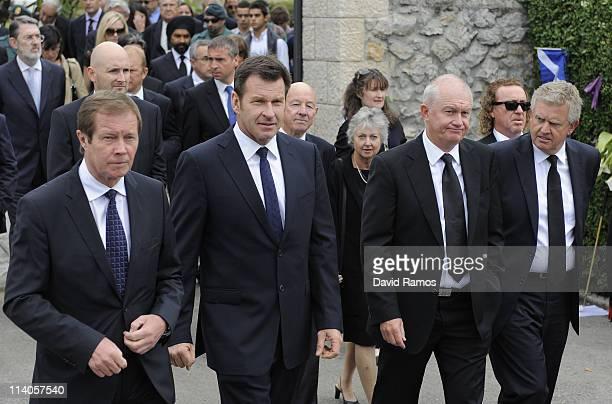 Chief Executive of The European Tour George O'Grady Nick Faldo of England Roger Chapman of England and Colin Montgomery of Scotland walk following...
