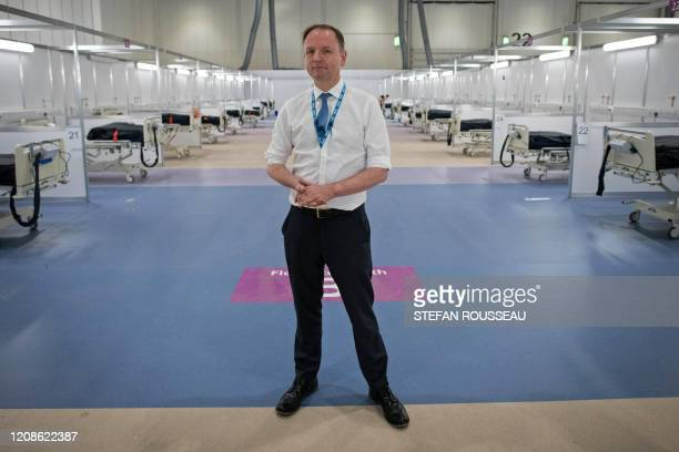 Chief Executive of the National Health Service Simon Stevens poses for a photograph during a visit to the ExCel centre in London on March 30 which...