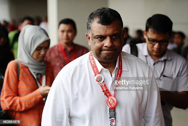 Chief Executive Officer AirAsia Group Tony Fernandes attends a press conference on search efforts for missing AirAsia flight QZ8501 at the crisis...