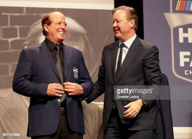 Chief Executive Officer and Chairman Brian France presents Ron Hornaday Jr with his Hall of Fame jacket during a banquet before the NASCAR Hall of...
