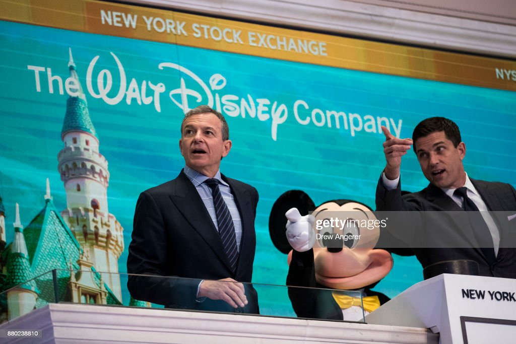 Chief executive officer and chairman of The Walt Disney Company Bob Iger and Mickey Mouse look on before ringing the opening bell at the New York Stock Exchange (NYSE), November 27, 2017 in New York City. Disney is marking the company's 60th anniversary as a listed company on the NYSE.