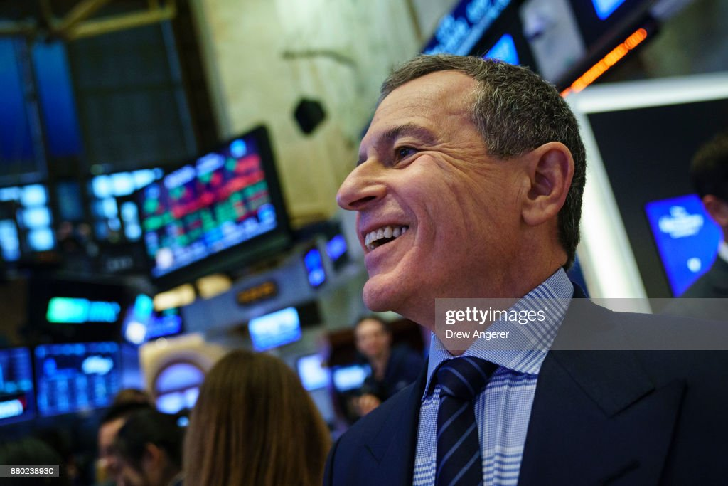 Chief executive officer and chairman of The Walt Disney Company Bob Iger walks on the floor of the New York Stock Exchange (NYSE) before ringing the opening bell, November 27, 2017 in New York City. Disney is marking the company's 60th anniversary as a listed company on the NYSE.