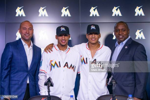 Chief Executive Officer Derek Jeter of the Miami Marlins Cuban baseball players and brothers Victor Victor Mesa Victor Mesa Jr and President of...