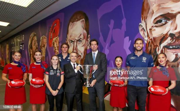 Chief Executive Officer Gillon McLachlan and Virgin Australia CEO and Managing Director John Borghetti along with Tom Hawkins of the Cats and Charlie...