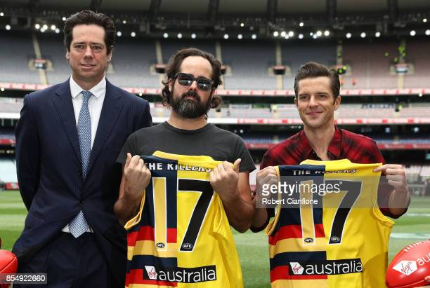 Chief Executive Officer Gillon McLachlan poses with Ronnie Vannucci Jr and Brandon Flowers of the Killers during an AFL Grand Final Press Conference...