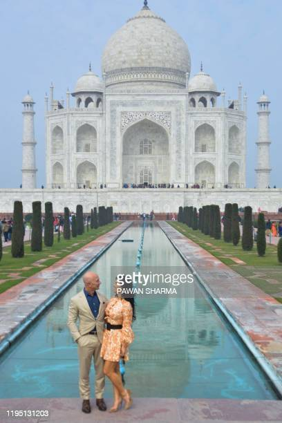 Chief Executive Officer of Amazon Jeff Bezos and his girlfriend Lauren Sanchez pose for a picture during their visit at the Taj Mahal in Agra on...