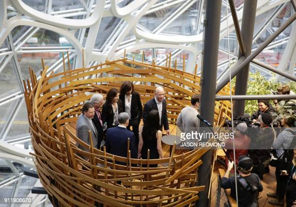 Chief Executive Officer of Amazon Jeff Bezos tours the facility at the grand opening of the Amazon Spheres in Seattle Washington on January 29 2018 ...