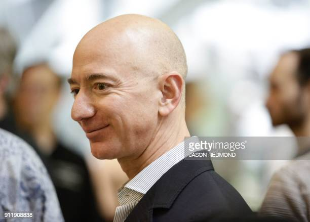 Chief Executive Officer of Amazon Jeff Bezos tours the facility at the grand opening of the Amazon Spheres in Seattle Washington on January 29 2018...