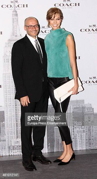 Chief Executive Officer of Coach Victor Luis and Karlie Kloss attend the opening of 'Coach New York' Flagship Store on November 20 2013 in Madrid...