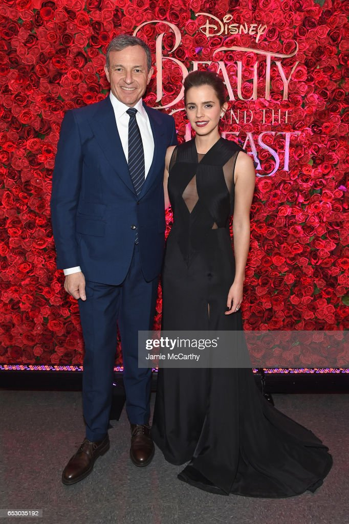 Chief Executive Officer of Disney Bob Iger (L) and actress Emma Watson pose backstage at the New York special screening of Disney's live-action adaptation 'Beauty and the Beast' at Alice Tully Hall on March 13, 2017 in New York City.