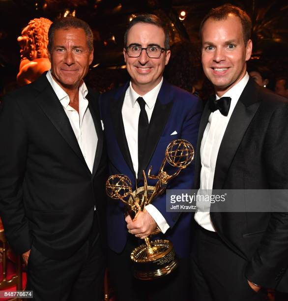 Chief Executive Officer of HBO Richard Plepler John Oliver and President of HBO Programming Casey Bloys attend the HBO's Official 2017 Emmy After...
