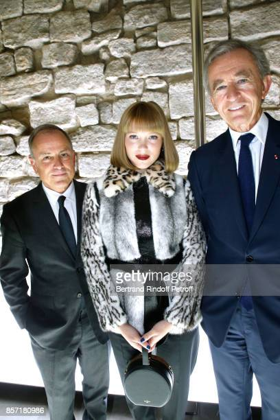 Chief Executive Officer of Louis Vuitton Michael Burke Lea Seydoux and Owner of LVMH Luxury Group Bernard Arnault attend the Louis Vuitton show as...
