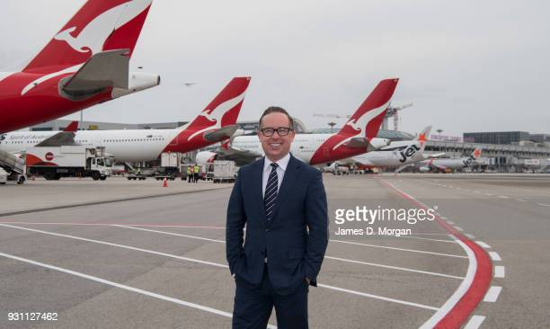 Chief Executive Officer of Qantas Alan Joyce stands on the apron with five Qantas and Jetstar aircraft lined up at Changi Airport on March 12 2018 in...