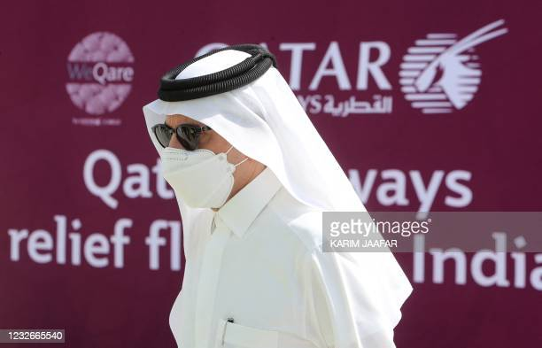 Chief Executive Officer of Qatar Airways Akbar al-Baker supervises workers loading 300 tonnes of medical aid to be flown in a three-flight cargo...