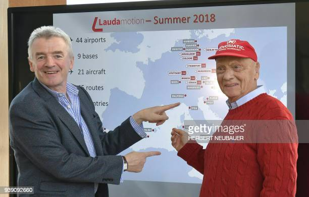 Chief Executive Officer of Ryanair Michael O'Leary and Austrian entrepreneur in the aviation sector and former Formula One champion Niki Lauda hold a...