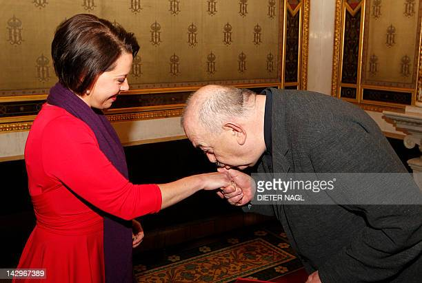 Chief Executive Officer of the Federal Theater Company Georg Springer kisses Swedish soprano Nina Stemme's hand after awarding her the official title...